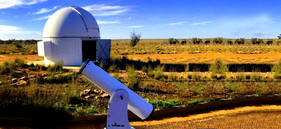 surprised Woomera amateur astronomers receive telescope