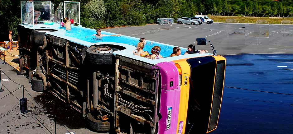 tipped over bus turned into public swimming pool