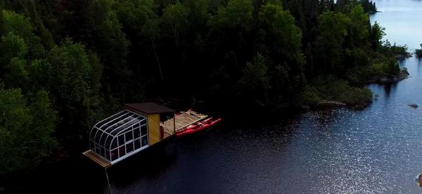 Tiny boat home on remote lake